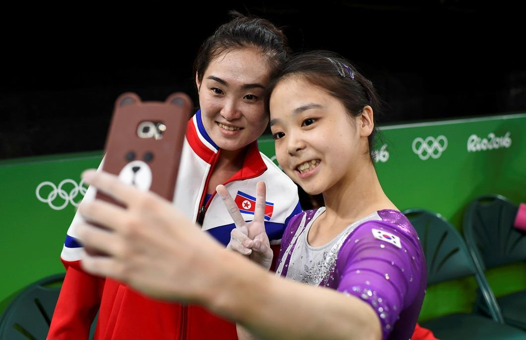 North Korean and South Korean athletes click a selfie together